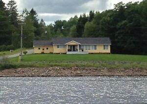 Gorgeous waterfront home just minutes to Woodstock!