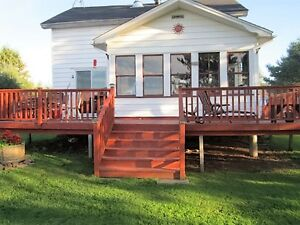 Two homes located on the Tobique river for sale