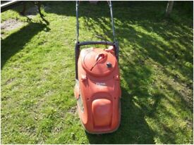Flymo Easyglide 380 with easy real and grass box collection, good condition recent new blade.