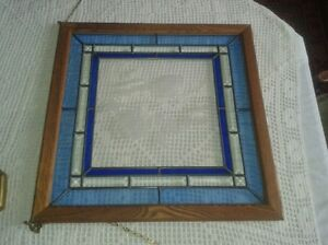Stylish stained glass piece in oak frame