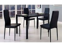 LIMITED STOCK OFFER *** Modern Large Glass and Black Metal Table & 4 Faux Leather Dining Chairs