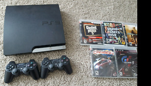 PS3 with games and two controllers