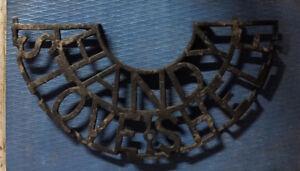 Cast iron sign.