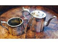 Silver plated sugar bowl and tea pot.