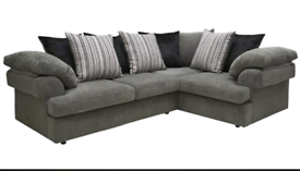 Grey fabric corner sofa and matching armchair