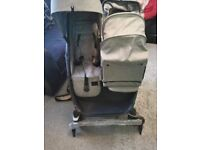 Double push chair with baby nesting basket
