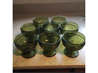 8 green glass bowls
