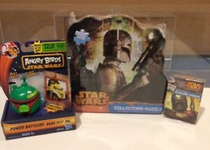 3 BOBA FETT COLLECTIBLES PUZZLE CARDS AND A TOY