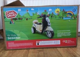 Chad valley 6v ride on scooter new in box