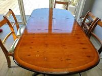 Maple Walnut extending dining table with 6 Chairs.