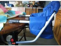 Portable Travel 'clip/clamp on' HIGH CHAIR SEAT, sits on dining table, padded, folds flat with bag