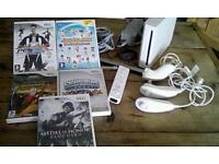 Nintendo Wii with leads and games