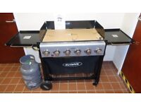 Outback Party 6 Burner Barbeque - unwanted gift. Never used. Gas tank included.