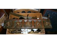 carved wooden panel with brass coat hooks antique carving