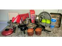 Used pots, pans, shaker bottles, trays, table cloths