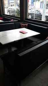 Granite tables and wicker benches