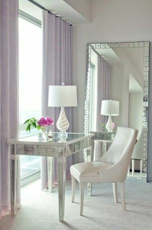 Cool lilac furnishings look great against this gorgeous glass console table