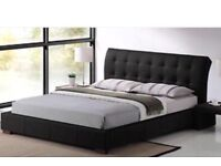 Brand new king size bed frame in box