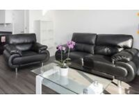 Almost new / perfect condition - 3 seater black sofa and matching armchair