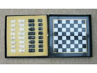 An unused, FULL Marble Chess Set