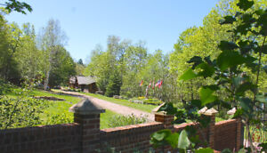 Lakeview Living: Custom 14 Acre Log Home Estate for Sale
