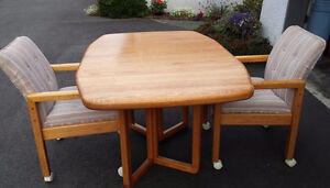 Oak Table and 4 Upholstered arm chairs