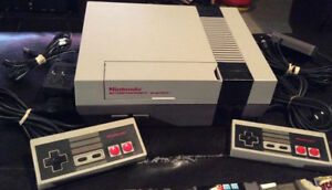 Nintendo NES With 2 Controllers/Gun and 3 Games