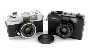Two Yashica 35-ME 35mm Viewfinder Cameras - Silver, Black