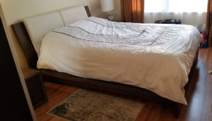 Queen size bed, solid wood, excellent condition. Canadian made.