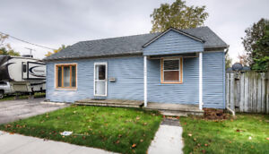 Welcome to this 888 sqft bungalow with a very wide lot!