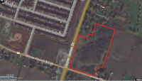 14.39 acres corner highway 6 & White Church +Sign income