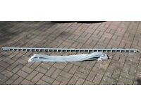 Vertical blind grey rail and slats