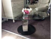 Heavy solid glass and chrome coffee table