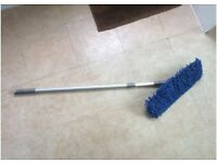 Broom with adjustable handle