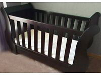 Mahogany sleigh cot - Mattress available if needed.