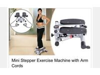 Mini stepper exercise machine with arm cords