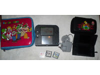 Nintendo 2ds with 3 games and super mario case and a nintendo ds lite console