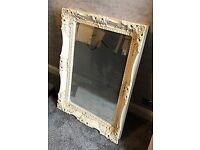 Ornate cream mirror