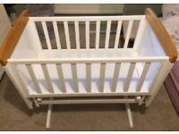 Beautiful swinging crib and new mattress
