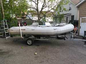 15 foot inflatable with trailer and trolling motor.