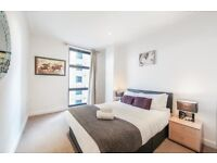 HOLIDAY LET - SHORT LET 2 BED SERVICED APARTMENT IN MILLHARBOUR MINS TO CANARY WHARF WITH BALCONY