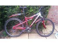 "Mountain bike .good cond, shimano 18 gears, 26"" wheels, Apollo metallic red/ silver rear suspension"