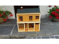 Dolls house with some furniture and electric lighting