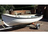 12' GRP Clinker style rowing boat with Seagull Outboard