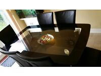 Glass dining table with six chairs.