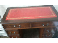 DESK WITH RED LEATHER TOP. TWIN PEDESTAL, SMALL NEAT SIZE.