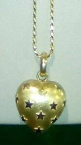 18 Karat Gold Necklace with Heart $450