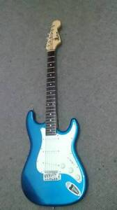 Red Fox Stratocaster electric guitar.Metalic blue