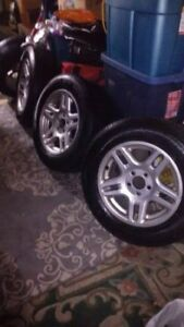 "P235/60R16 tires (4) on 16"" Alloy Wheels"