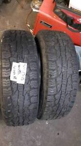 A set of two 235/75R15 all season Wild Country tires